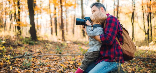 mature father and a toddler in an autumn forest